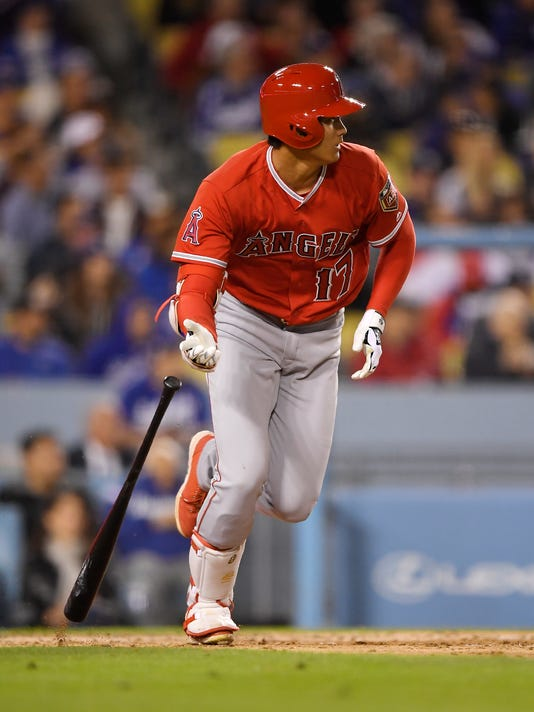 Los Angeles Angels' Shohei Ohtani, of Japan, runs after hitting a single during the fourth inning of a preseason baseball game against the Los Angeles Dodgers, Monday, March 26, 2018, in Los Angeles. (AP Photo/Mark J. Terrill)