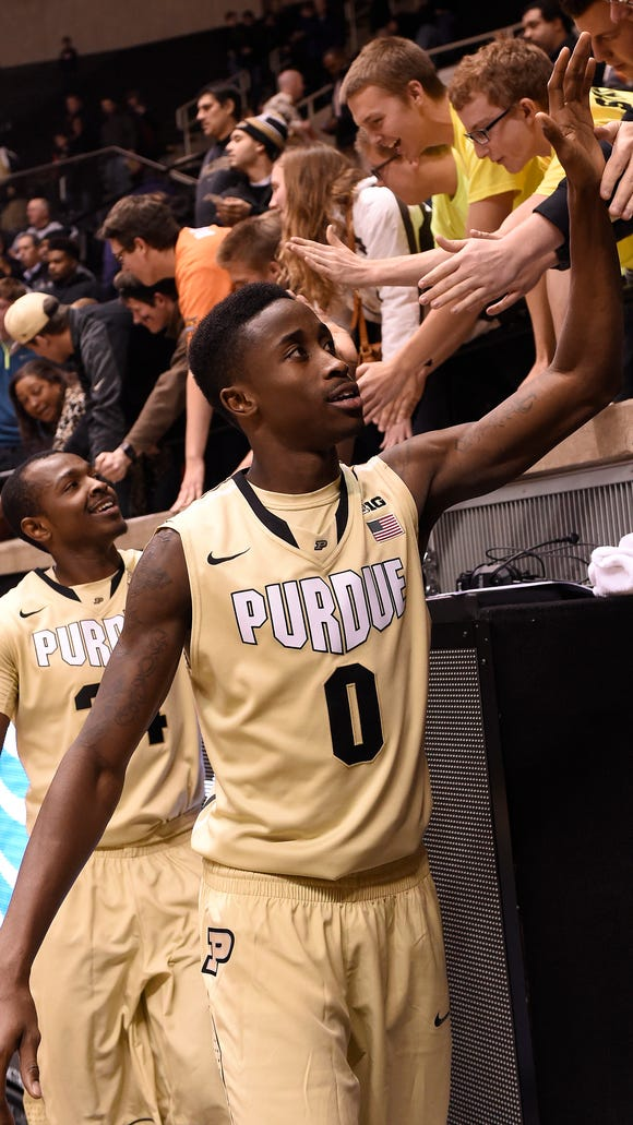 Nov 20, 2014; West Lafayette, IN, USA; Purdue Boilermakers guard Jon Octeus (0) slaps hands with the fans after the game at Mackey Arena. Purdue won the game 82-30. Mandatory Credit: Sandra Dukes-USA TODAY Sports