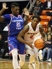 UTEP's Omega Harris draws a foul from Exavian Christon,
