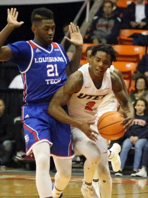 UTEP's Omega Harris draws a foul from Exavian Christon, 21, of Louisiana Tech while dribbling downcourt Thursday.