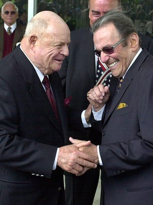 Comedians Don Rickles, left, and Norm Crosby arrive for a 2002 ceremony honoring comedian Milton Berle in Los Angeles. Crosby, the deadpan mangler of the English language who thrived in the 1960s, '70s and '80s as a television, nightclub and casino comedian, has died. He was 93.