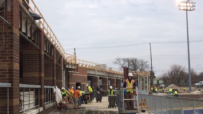 Construction workers continue to build a concourse patio at Cooley Law School Stadium in downtown Lansing.