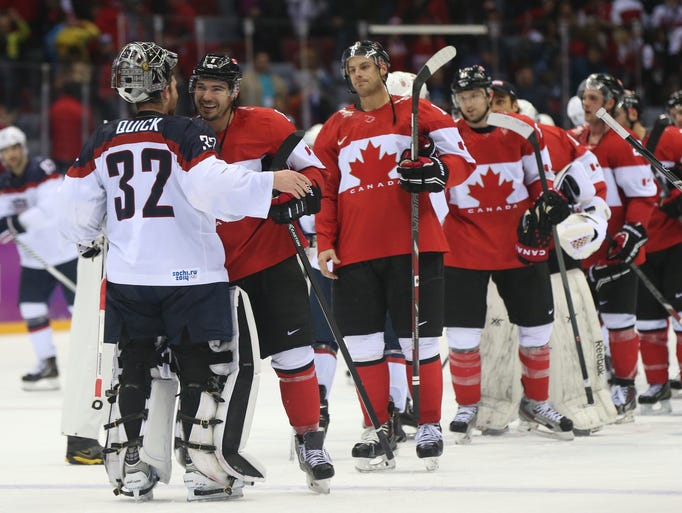 USA goalie Jonathan Quick (32) is greeted by Canada defenseman Drew Doughty (8) following the men's ice hockey semifinals. Canada won 1-0.