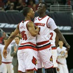 Louisville's Deng Adel, right, bumps chest with teammate Donovan Mitchell after Adel made a lay-up drive in the first half during the Cards' 79-47 win over Boston College Saturday afternoon at the KFC Yum! Center. Feb. 6, 2016