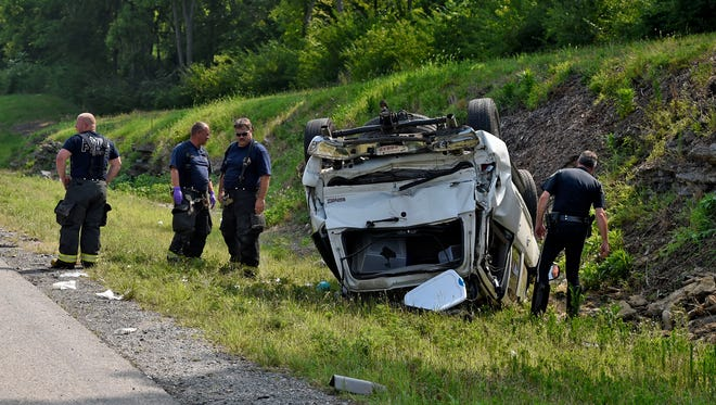 Metro Police and members of Nashville Fire Dept. investigate an accident on Interstate 40 eastbound involving a dump truck, a SUV and a car Tuesday July 28, 2015, in Nashville, Tenn.