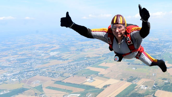 Danny Michewicz of Reading, who has been skydiving for 33 years, gives a thumbs up as he jumps above Donegal Springs Airpark with the Maytown Sport Parachute Club in this 2016 photo.
