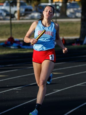 Arrowhead senior Kayla Vogt runs the anchor leg for her team as they win the 4x800 meter relay during the Classic 8 Girls Conference Relays at Arrowhead on Monday, April 23, 2018.