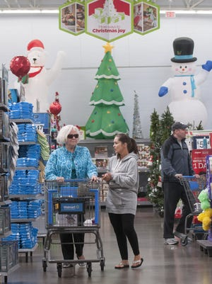 Walmart customers walk through one of the company's Dallas stores on Nov. 1. Christmas items and decorations were already up.