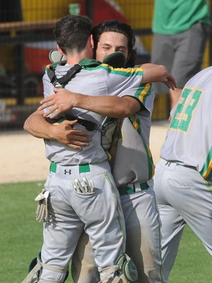 New Deal catcher Chris Beck hugs pitcher Brandon Coronado after Coronado's three-hitter beat De Leon 7-1 in Game 3 of the Region I-2A semifinal playoff series Saturday in Snyder.