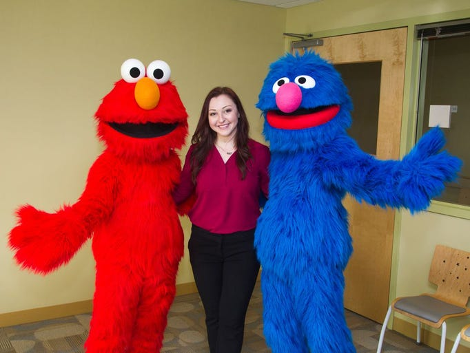 Elmo, Rachel Dresner (performance director), Grover.