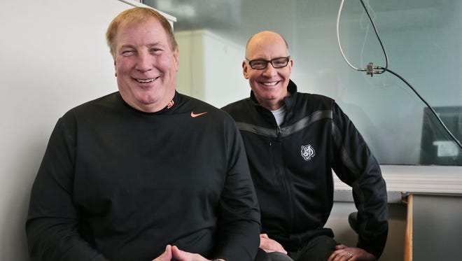 Bengals radio color commentator Dave Lapham, left, and play-by-play announcer Dan Hoard pose for a photo in the press box at Paul Brown Stadium, Tuesday, Dec. 13, 2016.