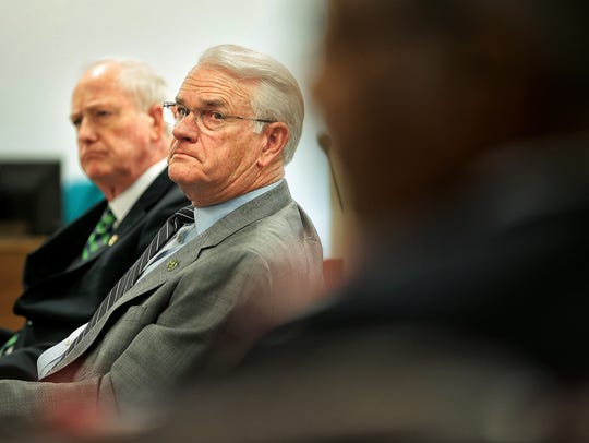 Shelby County Mayor Mark Luttrell (center) proposed the 2018-19 tax rate.