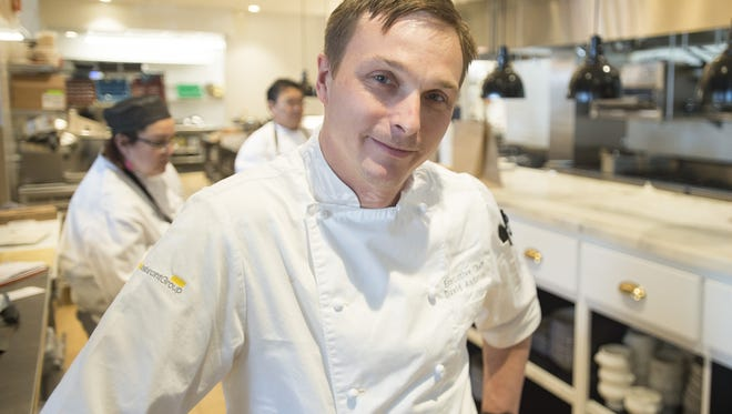Executive Chef David Anderson poses for a photo in the kitchen at The Emporium on Tuesday, December 12, 2017.