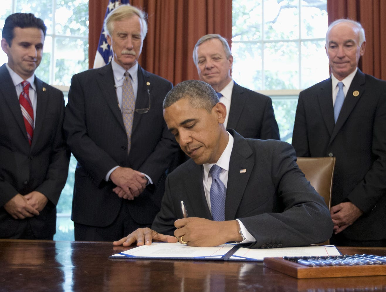 Officials watch as President Obama signs a bipartisan bill to cut student loan interest rates  Aug. 9 at the White House. Aug. 13 is International Left-Handers Day.