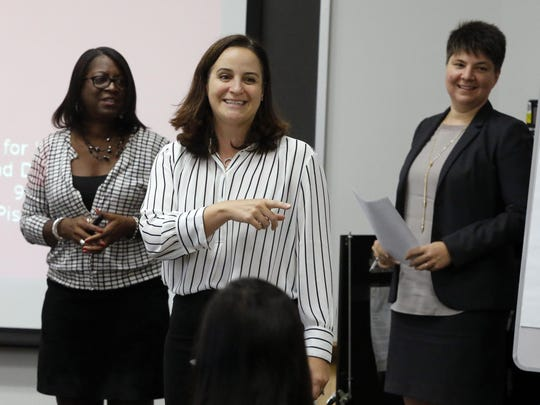 Terri Boyer (center) executive director of Rutgers Center for Women and Work, along with Connie Ellis (left), director of corporate programs and Elaine Zundl, research director, address a Rutgers leadership class for female executives.