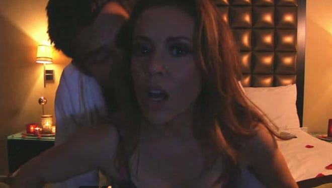 Alyssa Milano in a scene from her Funny or Die 'sex tape.'
