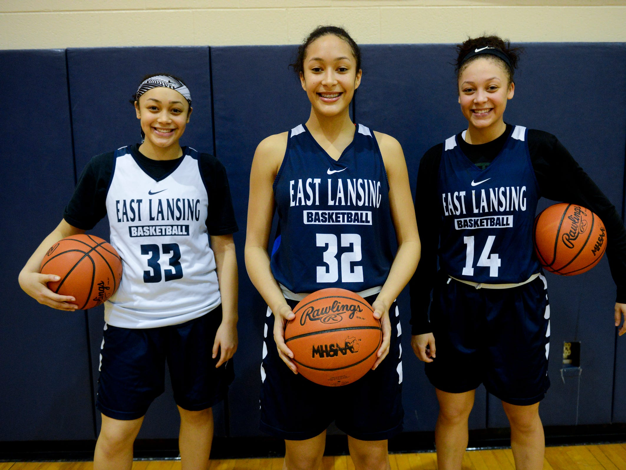 From left to right, sisters and East Lansing basketball players Aashawnti, Aaliyah and Aazh Nye pose for a portrait on Thursday, Feb. 23, 2017 at East Lansing High School.