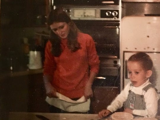 A candid snapshot captures a scene from Christmas break, 1970, as Candace, home from ASU, 1970 and Wayland Cooksey, 2 at the time, make pot-pies for lunch.