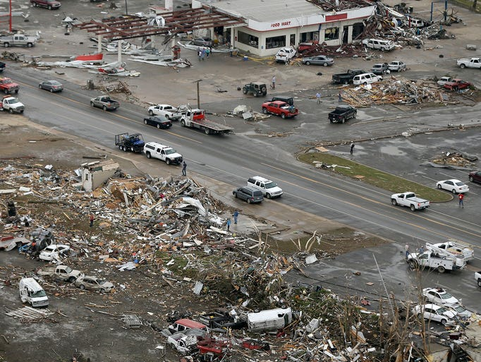 Homes and businesses are wrecked in downtown Vilonia, Ark.