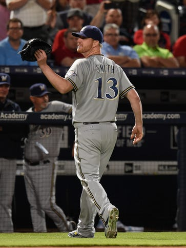 Brewers relief pitcher Will Smith reacts after he was