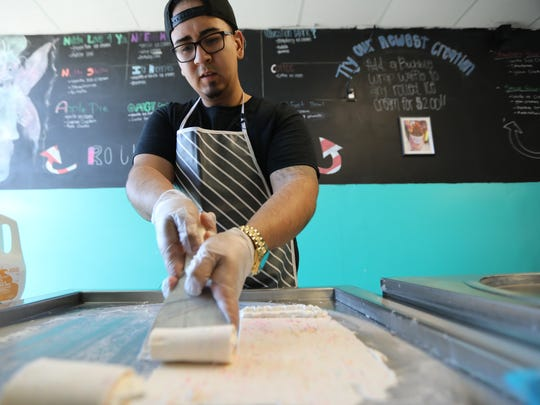 Miguelangel Cosme 22, demonstrates how he makes rolled ice cream in Lyndhurst. Thursday, March 23, 2017
