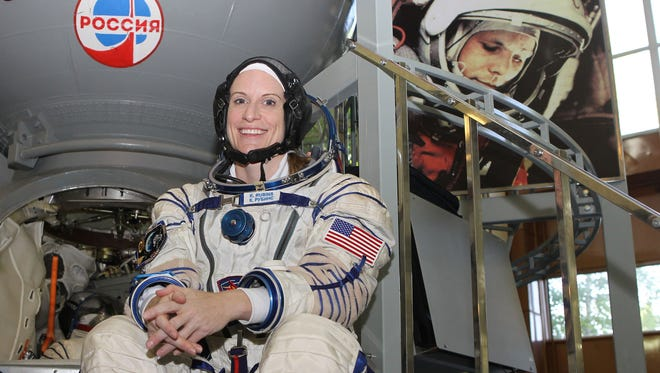 With a picture of Yuri Gagarin, the first human to fly in space peering over her shoulder, Expedition 48-49 prime crew member Kate Rubins of NASA posed for pictures May 27 at the Gagarin Cosmonaut Training Center in Star City, Russia before boarding a Soyuz simulator for final qualification exams. Rubins, Takuya Onishi of the Japan Aerospace Exploration Agency and Anatoly Ivanishin of Roscosmos will launch Wednesday, July 6, on the Soyuz MS-01 spacecraft from the Baikonur Cosmodrome in Kazakhstan for a four-month mission on the International Space Station.