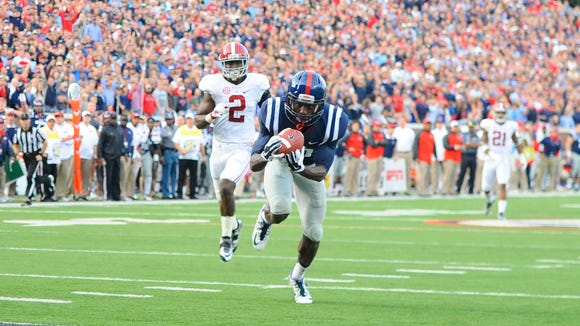 Ole Miss receiver Vince Sanders (10) scores to tie the game during the second half against Alabama Crimson Tide at Vaught-Hemingway Stadium. Mandatory Credit: Christopher Hanewinckel-USA TODAY Sports