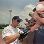 Detroit Tigers outfielder Chad Curtis signs autographs for fans April 17, 1995, in Lakeland, Fla.