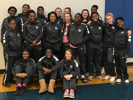 The Red River girls basketball team shows off their new travel gear purchased from a donation by Kansas City Chief's Bennie Logan.