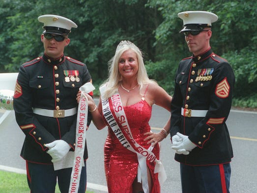 Toms River 7/3/99 Miss Superbowl Sondra Fortunato is flanked by marines Sgt. Ron Bohlayer (left) and marine staff sgt. Paul Rieper outside her estate. The marines were guarding the gate during Sondra's 3 rd annual celebrity party Saturday night.