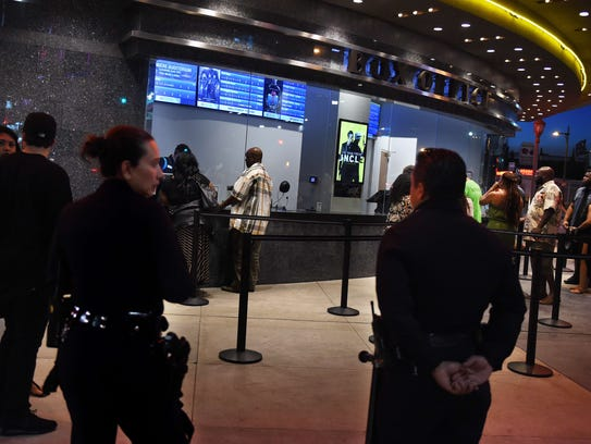 LAPD officers keep watch outside a Regal theater in