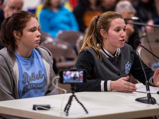 "From left, South Burlington high school students Amber Groves and Amy Lafferty speaks at Wednesday night's school board meeting in favor of keeping the ""Rebel"" name, saying that the name has become a positive face for the school that had long ago stripped it of any racist meaning or intent."