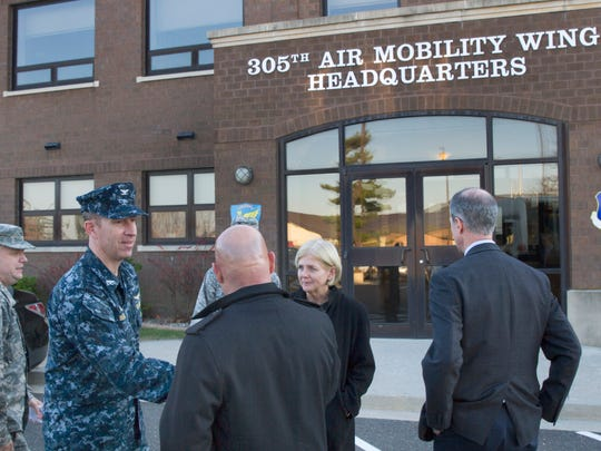 Captain Christopher Bergen greets the visitors outside 305th Air Mobility Wing Headquarters prior to tour of a KC10. Congressman Tom MacArthur  hosted House Armed Services Committee Chairman Mac Thornberry and his wife Sally on a tour and briefing at at Joint Base McGuire-Dix-Lakehurst to look over the benefits of Joint Bases vs Separate Armed Service bases and the usefulness of KC10 aircraft, which are endangered. Tour on December 4, 2015 in Wrightstown, NJ.