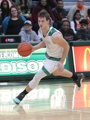 Madison's Mason Campbell dribbles the ball down the