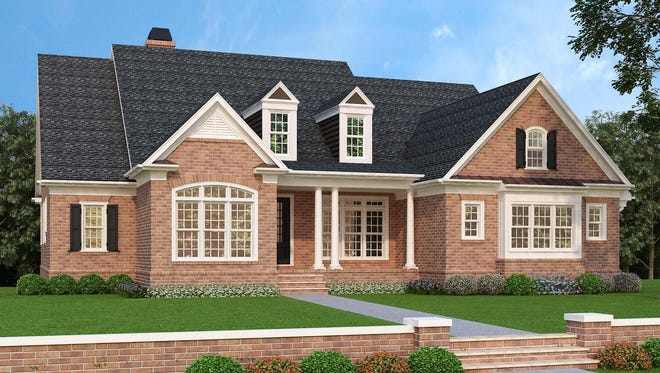 Graceful columns and brick siding create a timeless exterior that would fit well in a traditional neighborhood.