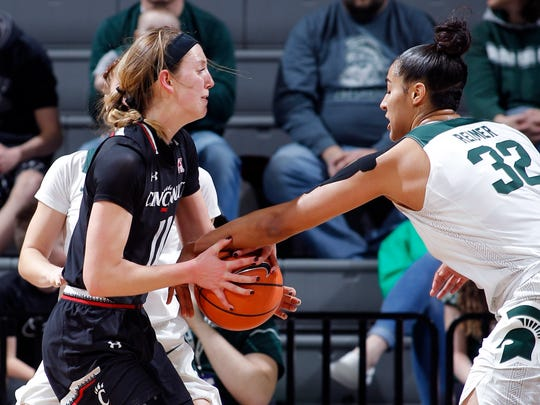 Michigan State's Taya Reimer, right, reaches in to