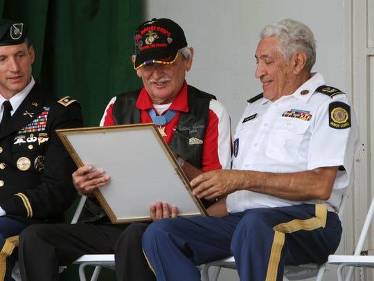 From left, U.S. Army LTC Judd Floris, U.S. Marine Corps.