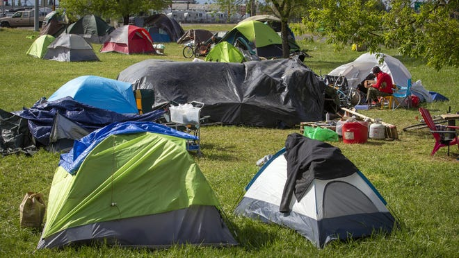 Tents were set up at a camp at Fifth Avenue and Highway 99 in west Eugene in early May. When the pandemic stay-at-home order was in effect, the city of Eugene allowed homeless to camp where it was typically illegal. [Andy Nelson/The Register-Guard] - registerguard.com