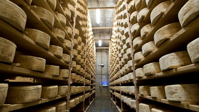 Cheddar cheese ages in one of the cellars at Jasper Hill Farm in Greensboro on Thursday, January 16, 2014.