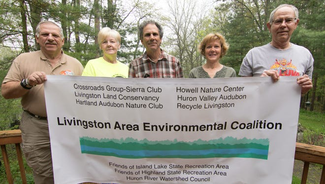 Shown from left Monday, May 14, 2018, Dick Russell of the Friends of Highland State Recreation Area, Debbie Stempien of Recycle Livingston, Lee Burton, chair of the Crossroads group of the Sierra Club, Karen Pierce of the Crossroads group and John Wilson of Friends of Island Lake State Recreation Area are among the Livingston Area Environmental Coalition, providing strength in numbers to environmental groups.