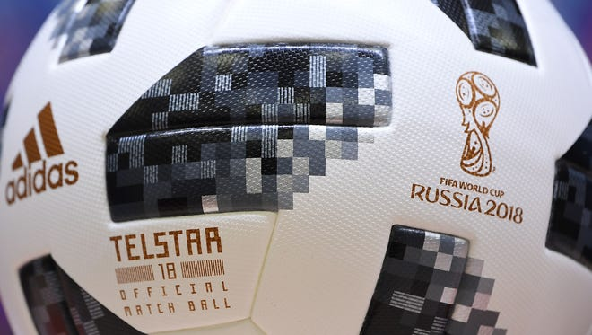 The Telstar 18 official match ball is displayed at a news conference at Kaliningrad Stadium in Kaliningrad, Russia, on June 21,