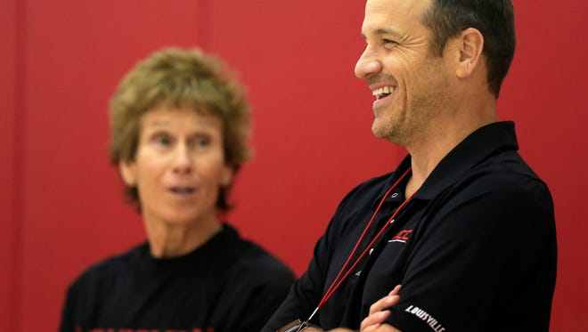 University of Louisville women's basketball coach Jeff Walz, right, talked with assisntant coach Beth Burns during practice. Oct. 30, 2017.