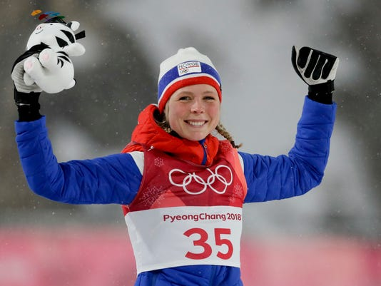 Maren Lundby, of Norway, celebrates after winning the gold medal in the women's normal hill individual ski jumping competition at the 2018 Winter Olympics in Pyeongchang, South Korea, Tuesday, Feb. 13, 2018. (AP Photo/Kirsty Wigglesworth)