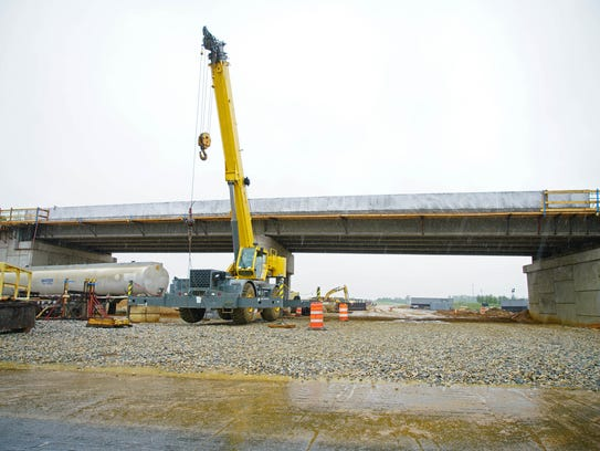 Construction equipment near the Bunker Hill Road overpass of the U.S. 301 tollway.