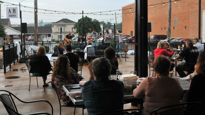 The Shonk Brothers played on the patio at Ale House 1890 as part of the Sweetwater Summer Music Series Friday night in Lancaster.