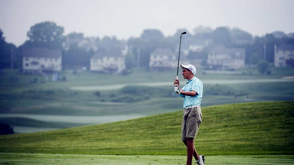 Despite losing their top three golfers, Andrew Forjan, shown here at the YCJGA George Barton Match Play Championships at Springwood in July, and the Fighting Irish have a chance to clinch the YAIAA Division III golf title on Tuesday. (Shane Dunlap - The Evening Sun)