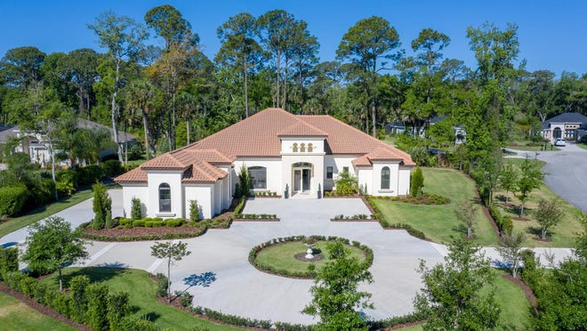 "Nestled on nearly an acre in the prestigious community of Wild Oaks, this grand estate was ""designed with entertainment in mind."