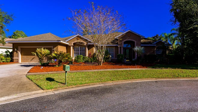 This stunning three-bedroom, two-bath home in Halifax Plantation is located on a quiet cul-de-sac and is complimented by tropical landscaping and a lake view from the gorgeous lanai area.