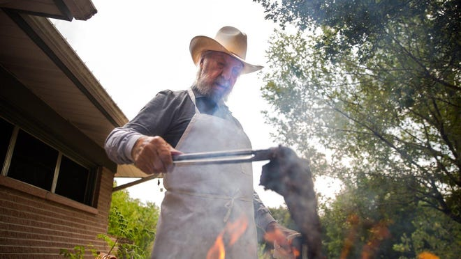 """Juan Antonio """"Sonny"""" Falcón, who popularized the fajita while he was a resident of Kyle 50 years ago, grills an outside skirt steak cut to make fajitas at his Austin home in 2019. The Kyle City Council is considering changing the name of a road in the city called Rebel Drive to Fajita Drive in honor of Falcón's creation."""