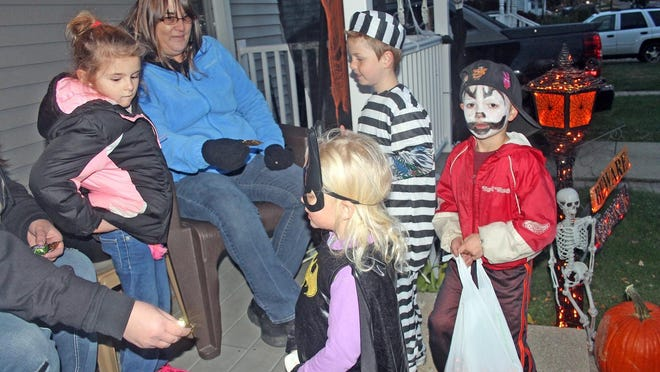 Children trick-or-treat in 2017 during Halloween in the city of Hillsdale .
